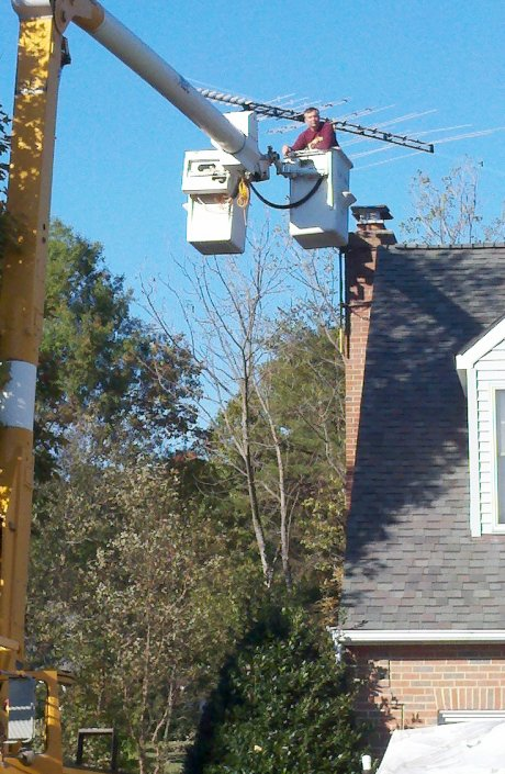 Servicing a TV antenna with our 56 foot bucket truck